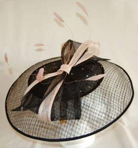 Pale pink loops and feathers were added to a plain black hatinator