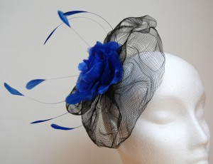 A well-worn fascinator was given a new lease of life; hand-dyed silk flower and feathers added