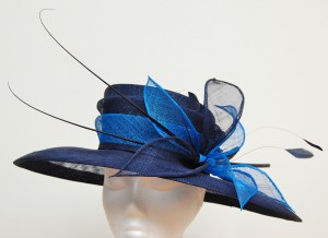 Navy hat with tilted crown, large oblong brim and contrast decoration
