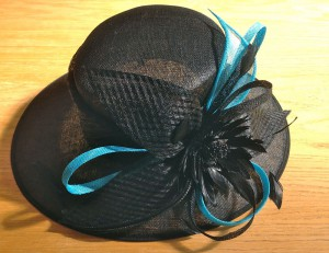 The plain black hat needed a flash of colour, so a petal and loops were added