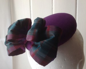 Velvet button with tartan silk bow