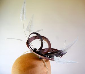 Mink and grey sinamay loops with misty grey feather decoration